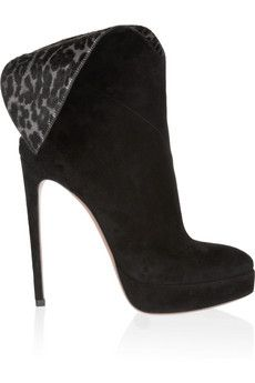 Black skinny pants tucked into black booties will elongate the leg and make you feel fabulous. Alaïa
