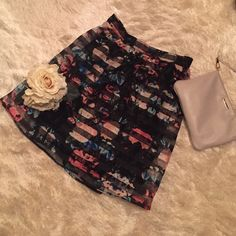 """Xhilaration Floral Skirt - NWT  NWT Black skirt with floral accents, shear design, with solid black lining. My FAVORITE part about this skirt .. It has pockets! ❤️❤️❤️ Skirt is flowy, and comfortable. Measures 19"""" from waist band. Selling because I am 5'1"""", and this skirt is a bit longer than I would like. Size Medium. Elastic back waist band. Would look great with sandals, or black tights and booties! Xhilaration Skirts"""