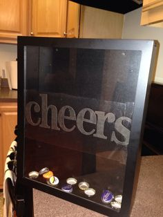 Shadow box for beer caps. Put stickers on contact paper, then the contact paper on the inside of the glass!