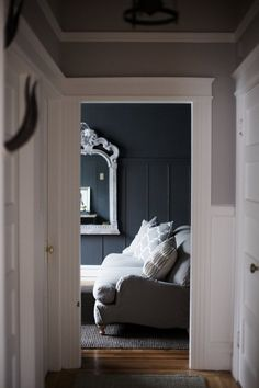 White trim, grey walls, dark midnight blue room