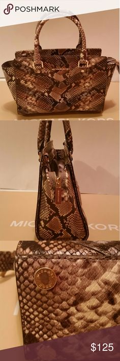 Michael Kors medium embossed chevron satchel Authentic  Preowned Good condition  Missing long strap but the rest of the bag is in great condition.  Gold hardware Scratch on the base hardware which is expected from resting on surfaces Zip top closure Approx 11l x 4w x 8h Zip top closure Michael Kors Bags Satchels