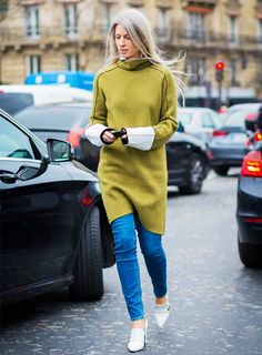 Sarah Harris wears a paneled long sweater over skinny jeans and finishes off the look with white heeled loafers
