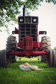 Newborn baby boy with tractor http://kerihamiltonphotography.com http://facebook.com/kerihamiltonphotography Instagram: @kerihamiltonphotography