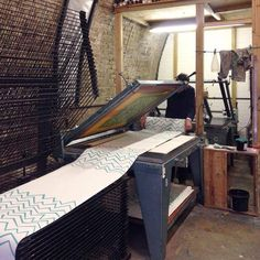 Tom Marynaik printing the first layer of his 3 colour spot repeat wall paper ~ Peckham Print Studio  @peckhamPS