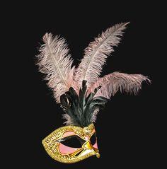 An elegant masquerade captures the heady glamour of the  roaring 30s.  Via Carla Alta Venetian Masks.