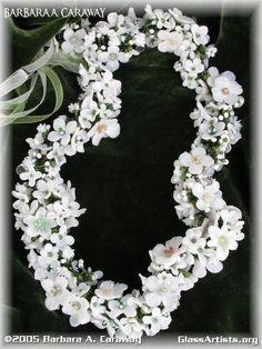 Bridal wreath by Barbara Caraway.  Bullseye glass
