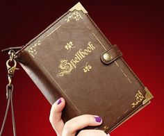 Feel like a mighty sorcerer every time you make a purchase by storing all your cash in this spellbook wallet. Styled to look like an ancient spellbook, it features a divided zipper pocket along with an ID slot and 14 additional card slots.