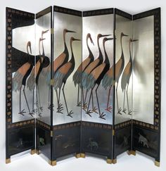 """ART DECO 6-PANEL COROMANDEL SCREEN with crane decoration on silvered background, lower panels with various animals, back with carved bird and duck populated landscape, 84""""h; each panel 18""""w  Prov: Consignor's mother purchased at the Liberace Estate Auction, 1988"""
