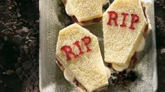 """""""Coffins"""" fashioned from bread and filled with peanut butter and jelly make the perfect Halloween lunch for your little skeletons!"""