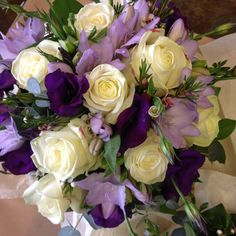 Brides bouquet, white avalanche, purple lisianthus and lilac freesias