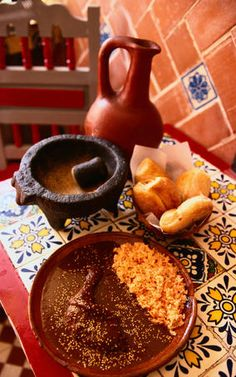 Local cuisine: Mole Poblano  (hot chilies, bitter chocolate usually served with chicken or turkey) and molcajete (mortar and pestle).
