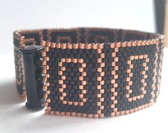 This bracelet is handmade, adding beads one by one in peyote stitch. It is beaded of high quality Japanese miyuki delica beads, using colors green avocado, luster linen, opaque black and gray.  This bracelet is lightweight and very comfortable to wear.  This bracelet will be delivered with extensions chain, so it fits most wrists.  Thank you for visiting my shop!  For more items: https://www.etsy.com/nl/shop/MarmosaArt?ref=hdr_shop_menu