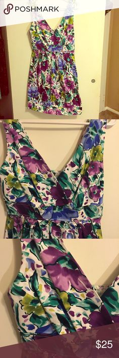 Floral A-line, fit and flare dress. Size 9/10. Floral dress from Maurice's in excellent condition. The dress has a v neck and is an a-line, fit and flare. There are two buttons on the straps to adjust the length. The material is a nice, thicker fabric and it does not wrinkle easily. Maurices Dresses