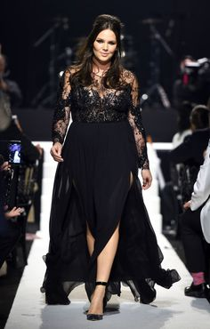 Unique long sleeve #plussizedresses can be difficult to find. Here is one from the #fashion runway that is sure to please. This #black illusion neckline evening dress has sheer beaded sleeves. The skirt on this plus size formal gown is flowing and elegant. Allow our USA based design firm to replicate this celebrity evening gown for you at a reasonable price. We specialize in custom #plussizeeveningdresses (and replicas) at www.dariuscordell.com