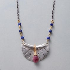 """AMULETO ROJO NECKLACE--Flanked by lapis rondelles, a ruby bedecks our sterling silver amulet. With 14kt gold filled wire, lobster clasp. Exclusive. Handmade in USA. 16-1/2"""" to 18""""L."""