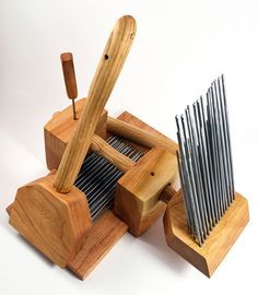 Custom-made wool combs and clamping system.