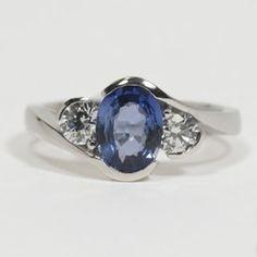 18ct White Gold Cross Over Blue Sapphire & Diamond Ring From £2985 Designed by John Watling    Watling Goldsmiths of Lacock, UK www.watlings.com