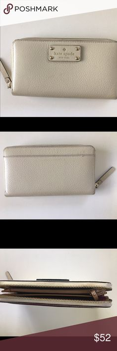 Cream Kate Spade Wallet Very minor nicks on the back near stitching (pictured). 12 card slots, zipper/change compartment, two long open slots along interior, one slot on exterior of the back. kate spade Bags Wallets
