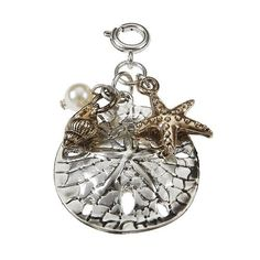 Jane Marie silver sanddollar charm available in silver and gold. #carolescollections #janemarie