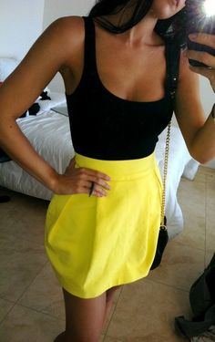 Summer outfit - yellow high waisted skirt / black tank top-- I would wear this on a Saturday night out in Chi town!