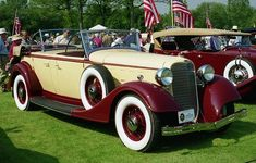 1934 Lincoln KB Maroon and Yellow, Dual Cowl Phaeton Touring Car.