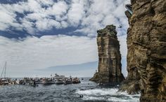 cliff diving, portugal, note the diver from the smaller cliff to the right, then note what looks like a platform on the bigger cliff. - click to enlarge