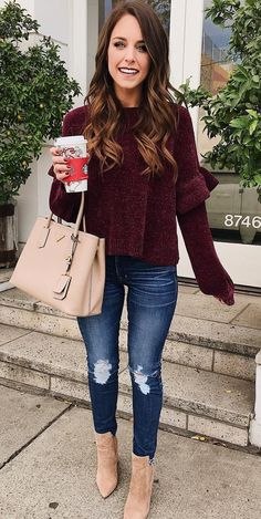 #winter #outfits women's maroon sweatshirt, distressed blue jeans, and brown boots outfit. Click To Shop This Look.