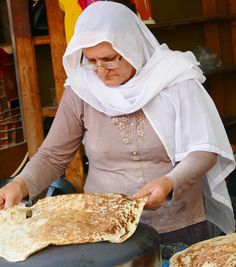 Druze woman making bread at the #shukhacarmel