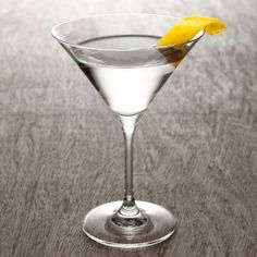 VODKA MARTINI - 1 ½ oz vodka + ¾ oz dry vermouth + olives or lemon twist - Traditional Martini is, in fact, shaken. Often served wt. olives. Try yours wt. a twist of lemon.