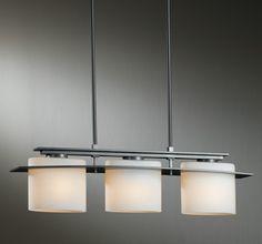 Adjustable Pendant: Arc Ellipse three-light with glass options Hubbardton Forge