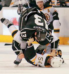 Los Angeles Kings left winger Kyle Clifford (13) and Boston Bruins defenseman Adam McQuaid