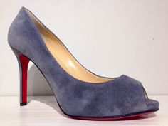 And for her, grey suede platform peep toe from Christian Louboutin.
