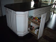 Same idea, but instead of a pull out drawer space make it out pull out island on casters with a butcher block top.  Thank way if we buy a house with a hallway kitchen or a small kitchen we can still have an island ready to use if we need the extra space.  As seen in Ikea's catalogue fall of 2011