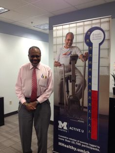 We're seeing double -- That's Dr. David Gordon standing next to his UM Flint #ActiveU banner! Thanks for being such a great spokesperson for MHealthy!