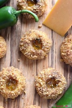 Cheddar Jalapeño Jelly Thumbprints ~ these savory appetizers are bursting with sharp cheddar and filled with sweet and spicy jalapeño jelly for a fun twist on classic thumbprint cookies | FiveHeartHome.com
