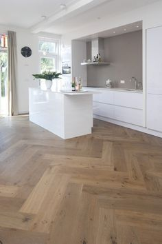 wood floor and white kitchen