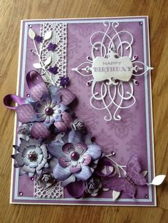 Card using craftwork flowers.
