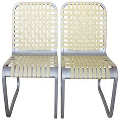 Mid Century Aluminum Chairs, 6 chairs available | From a unique collection of antique and modern dining room chairs at http://www.1stdibs.com/seating/dining-room-chairs/