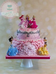 Pretty two-tier Disney Princess cake, models set customer supplied. Follow me at www.facebook.com/Cakes.at.Rachels for more awesome cakes!
