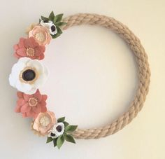 A personal favorite from my Etsy shop https://www.etsy.com/listing/580075042/rustic-farmhouse-felt-floral-wreath-jute