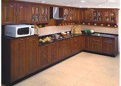Wooden modular Kitchen from nano Kitchen and Interiors :Ph:9349101300