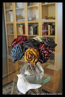"Rolled Roses using Ties • Joallie Petit says: ""It's amazing how gorgeous these ties can look on mass; and seriously, it's always the REALLY ugly ties that seem to work the best! They look so different when twisted. The thicker/longer the tie, the more larger/more bulky the rose will be."""