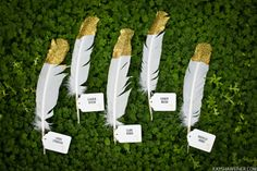 An absolute gorgeous idea when considering escort cards. Dip the top part of the feather in gold, while you can use either a white or plum colored feather as the main color. Use small tags which will list each guests' name and table number.