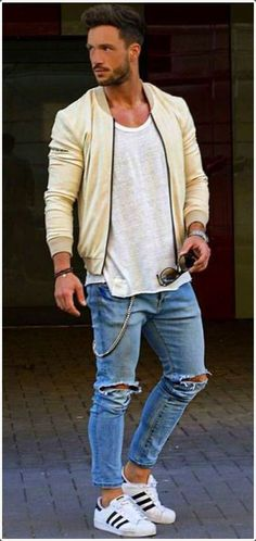 Ripped jeans plus a varsity jacket equals to a comfortable stylish outfit.