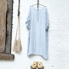 Our Hadley dress is made from a gauze linen,it has side pockets, double stitching and is designed to be worn loose. Our cotton slips work well with this dress. This is a delicate fabric and we recommend handwashing in cold water. Measurements    Small Bust 52 inches                      Length