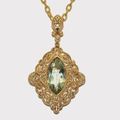 """Exquisite Fillagree Necklace Vintage style set with a 17 x 9 millimeter green amethyst surrounded by 46 beautifully cut fine white round brilliant cut diamonds weighing 0.40 carats with beautiful fillagree work and hanging on an 18"""" inch 14 karat yellow gold wound link chain.   # W096260  #pendant #amethyst #vintageinspired #wcd #windycitydiamonds"""