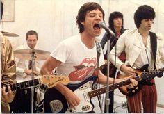 Mick Jagger playing a Jaguar