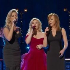 Kelly Clarkson Releases 'Silent Night' Video With Trisha Yearwood & Reba McEntire [READ MORE: http://uinterview.com/news/kelly-clarkson-releases-silent-night-video-with-trisha-yearwood-and-reba-mcentire-9819] #kellyclarkson #rebamcentire #trishayearwood #Holidaymusic #silentnight #CautionaryChristmasMusicTale #wrappedinred