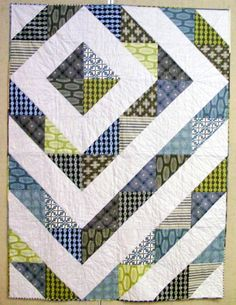 Love the off center and using half square triangles.  Add white or grey to any collection and you have a quilt!