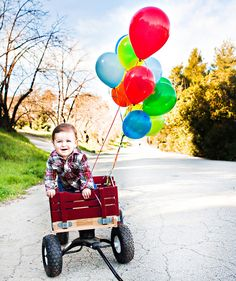 Boy, wagon & balloons. Couldn't be any cuter!